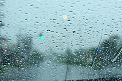 Road view through car window with rain drops Royalty Free Stock Photography
