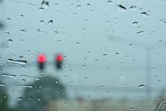 Road view through car window with rain drops Stock Images