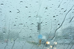 Road view through car window with rain drops.  royalty free stock photos