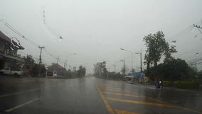Road view through car windshield with. Rain drops, Waiting for cross the road stock footage