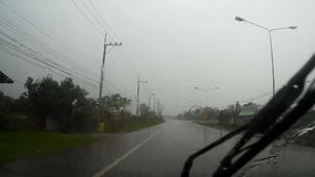 Road view through car windshield with rain drops, Waiting for cross the road stock video footage