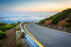Road and view of fog over the San Francisco Bay stock photos