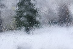 Road view through front car window with melted snowflakes and frost. Artistic view Stock Images