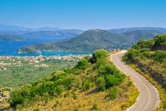 Road and view of landscape and the sea. VIew of landscape with road and sea with a lot of islands in the background Royalty Free Stock Image