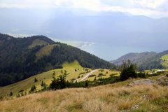 The road with view on the mountains and a lake in the clouds. Royalty Free Stock Images