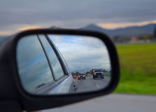 Road view in side mirror on a car Stock Photos