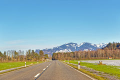 Road view on snow covered Swiss mountains Stock Photo