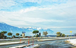 Road View of snow covered Switzerland Stock Photo
