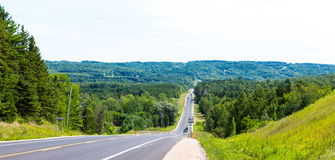 Road. View on sunny road on northern part  of Ontario Stock Photos