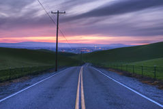 Road view Sunset. High dynamic image on a road, view to a far city Royalty Free Stock Photo