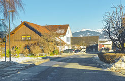 Road View of a Swiss village in winter Stock Photos