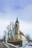 Road View to a church in Germany in winter Royalty Free Stock Images
