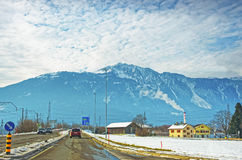Road View to village in snow covered Switzerland Royalty Free Stock Images