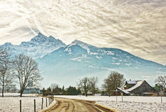 Road View of village in snow covered Switzerland Stock Photo