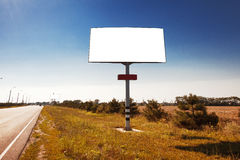 Road in a village with an empty billboard Stock Images