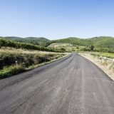 Road between Vineyards. Tuscany landscape with asphalt road and vineyards. Road between vineyards in Italy Royalty Free Stock Images