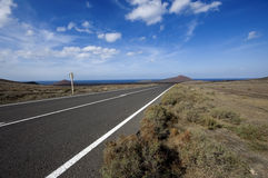 Road through volcanic area Stock Images
