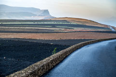 Road in the volcanic area of Lanzarote Stock Photography