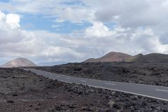 Road in the volcanic area of Lanzarote, Spain royalty free stock images
