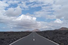 Road in the volcanic area of Lanzarote, Spain royalty free stock image