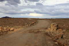 Road and volcanic field Royalty Free Stock Image