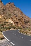 Road through volcanic land Stock Photos