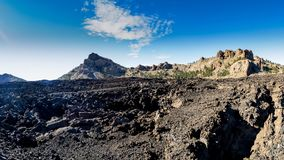 On the road,  volcanic land of Natural Park Teide volcano, Canary Islands, Spain royalty free stock images