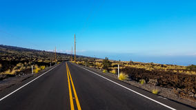 Road through volcanic landscape, Hawaii stock images