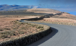 A road on volcanic landscape at  Lanzarote Island, Canary Island Stock Photography