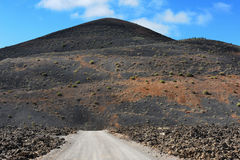 A road on volcanic landscape at  Lanzarote Island, Canary Island Stock Image
