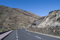 Road through volcanic landscape (Tenerife, Canaries, Spain) Royalty Free Stock Photos