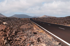 Road in volcanic scenery. Road in volcanic scenery at Lanzarote, Canary Island Stock Photography
