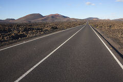 Road through volcanic terrain Royalty Free Stock Photography