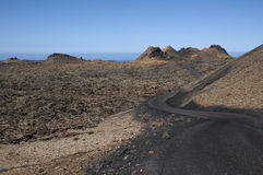 Road and volcanos Royalty Free Stock Photos