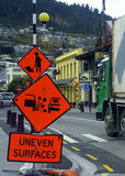 Road Warning. Men at work (under construction) sign and uneven surfaces warning signs Stock Image