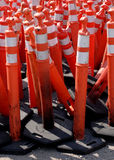 Road Warning Cones. Pile of orange or red caution cones used in road construction Stock Photo