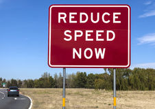 Road warning  sign - Reduce Speed Now Stock Photos