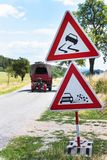 Road warning sign on slippery road. Spilled gravel on the road. Country road in the Czech Republic. Stock Photography