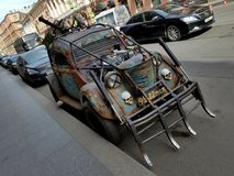 Road warrior custom design car. Road warrior skulls and spikes custom made car with open engine and rust all over the thing Stock Photo