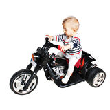 Road warrior - one year old baby on a motorcycle royalty free stock images