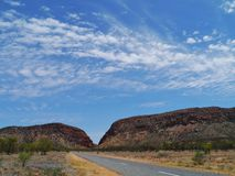 Road in the West Mcdonnell ranges. The Namatjira drive in the West Mcdonnell ranges in the Northern Territory in Australia stock photos