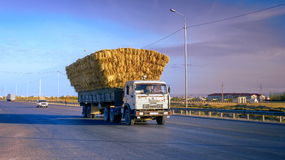 Road western europe western china. Old truck transporting food for the animals on the highway Western Europe-Western China, near the city of Turkestan stock image