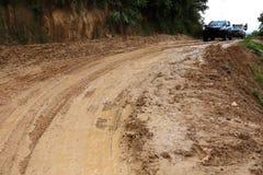 Road wet muddy Stock Photo