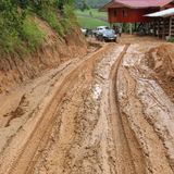 Road wet muddy Stock Photos