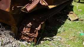 The road wheels and tracks of a tank. A hand held, close up shot of the road wheels and tracks of an abandoned war tank stock video