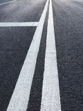Road with white marking diminishing perspective. Asphalt road with white marking diminishing perspective stock images