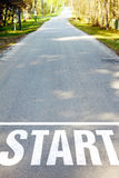 Road with white start sign. Asphalt road with white start sign Stock Image