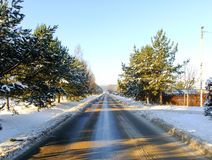 Road through white Winter Forest Stock Photo