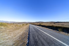 Road through wide valley Stock Photography