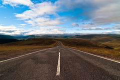 Road into the wild v1. Road into the wild with clouds Royalty Free Stock Photography